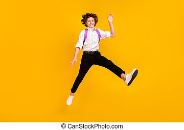 Photo of pretty friendly school boy wear white shirt rucksack smiling waving arm hi isolated yellow color background