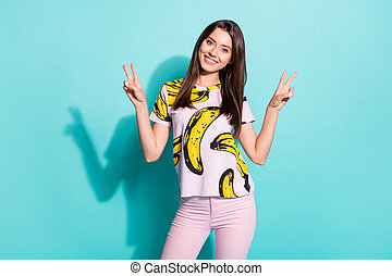 Photo of pretty lovely girl make v-sign enjoy rest relax weekend wear fruit print summer outfit isolated over teal color background