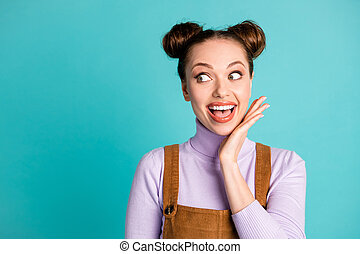 Photo of pretty lovely girlish funky crazy cunning lady two adorable buns look side empty space spring season price wear violet fall sweater brown overall isolated turquoise color background
