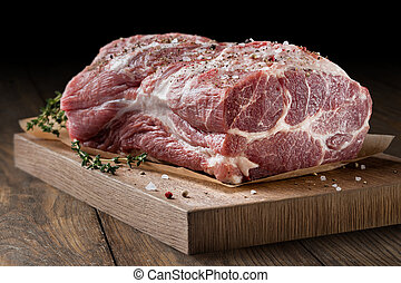 Photo of raw meat. Pork neck with herbs