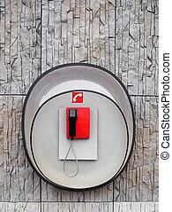 Photo of red phone on wall of modern building