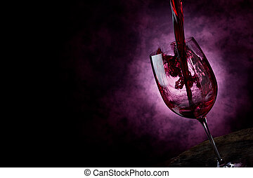 Photo of Red Wine inside a wine glass with abstract background