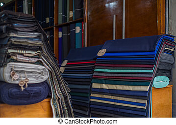 Rolls of textiles in a fabric shop. Multi colors and patterns.