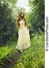 Photo of romantic woman in fairy forest. Beauty summertime
