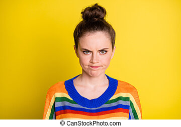 Photo of sad cute brunette girl wear rainbow sweater isolated on bright yellow color background