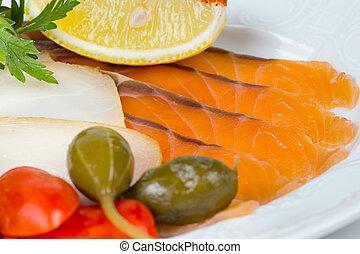 Photo of salmon snacks with lemon
