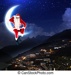 photo of santa claus sitting on the moon with a city and ...