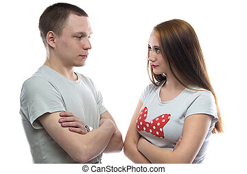 Photo of serious teenage boy and girl