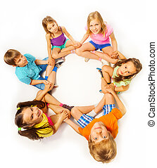 Photo of six kids in a lotus pose