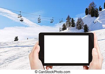 photo of ski lift and slope of Dolomites mountains