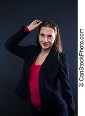 Photo of smiling woman taking off glasses
