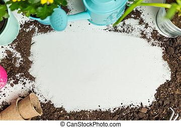 Photo of soil, watering can, flower pot, shovel, rake on empty white background.