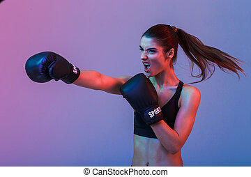 Photo of strong willed woman 20s in sportswear and black ...