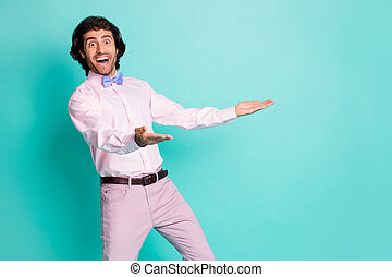 Photo of surprised bristle curly man dressed pink outfit open mouth open arms isolated turquoise color background