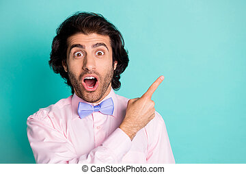 Photo of surprised cute funny boyfriend wear pink outfit pointing empty space open mouth isolated teal color background