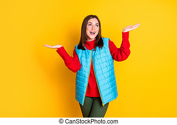 Photo of surprised girl have season walk hold hands impressed snowflakes falling copyspace wear good look outfit isolated over bright shine color background