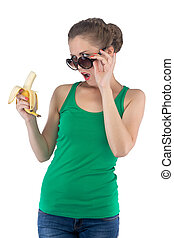 Photo of surprised girl with banana and sunglasses