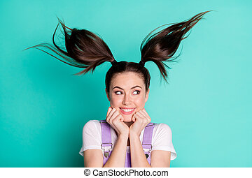 Photo of sweet lovely lady wear casual outfit looking empty space arms chin hair up isolated turquoise color background