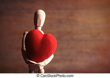 photo of the beautiful gestalta with heart-shaped toy on the brown wooden background
