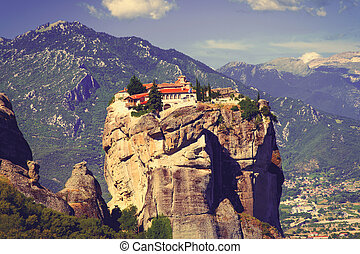 photo of the beautiful building on Meteora tock on the mountains backgorund