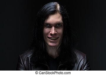 Photo of the man baring his teeth