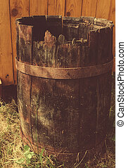 Photo of the old destroyed wooden barrel.