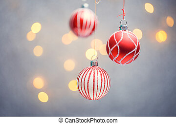 Photo of three Christmas tree red balls with pattern on gray...