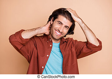 Photo of toothy smiling young man wear casual brown outfit two arms hair isolated beige color background