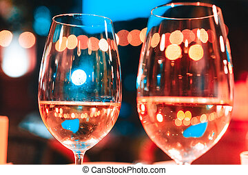 photo of two champagner glasses on table