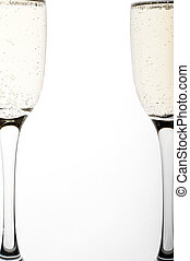 two glasses of champagne on white background