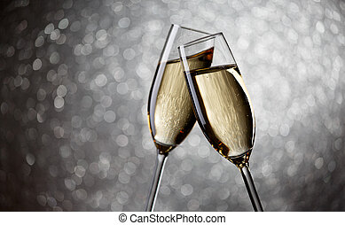 Photo of two glasses with champagne on gray background,