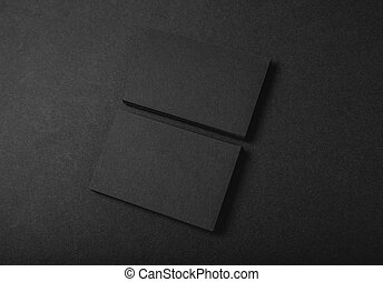Photo of two stack Of blank black business cards on textile background