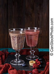 Photo of two wineglasses with smoothies on table