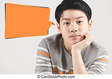 Photo of un happy boy looking at camera with orange dialog box .
