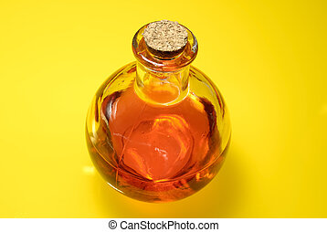 Photo of Vintage Bottle With Red Liquid on a Yellow Background
