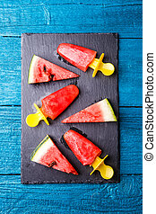 Photo of watermelon slices , fruit ice on cutting board