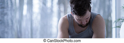 Photo of weary man