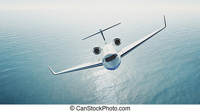 Photo of white luxury generic design private jet flying over...
