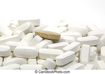 Brown Pill - Photo of White Pills and One Brown Pill