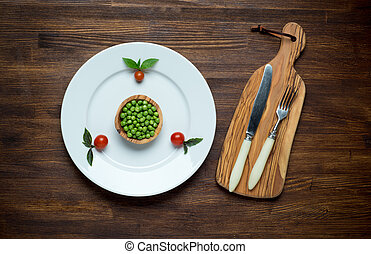 Photo of white plate with fresh diet vegetables. Top view