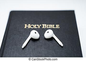 Photo Of White Wireless Headphones On Bible Book