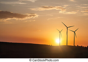 wind generator turbines on sunset