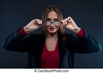 Photo of woman holding glasses