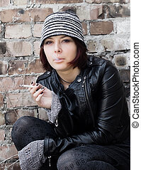 Photo of woman in grunge style smoking a cigarette