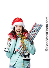 Photo of woman in Santa's cap with wrapping paper