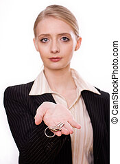 Photo of woman's hand holding a new key and pointing it at...