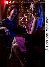 Photo of women at bar