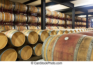 wooden barrels in  winery factory