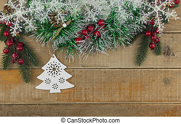 Photo of wooden table with Christmas decoration. Top view.