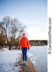 Photo of young athlete girl on morning exercise in winter